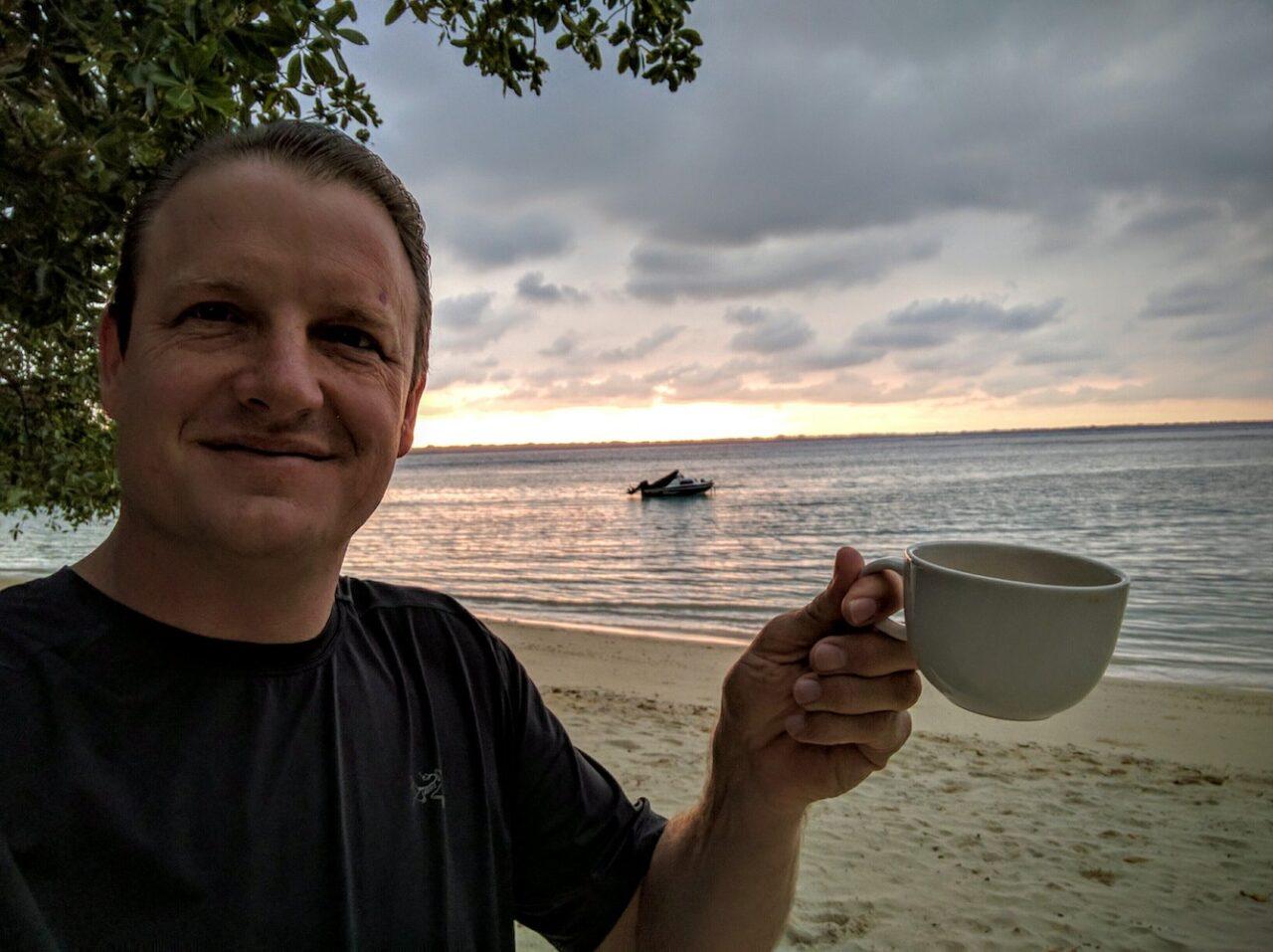 D – Joe having a morning _cup of joe_ on Moyyan beach in Vanuatu